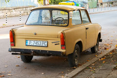 Old yellow Trabant 601s car stands parked on a street Royalty Free Stock Photo