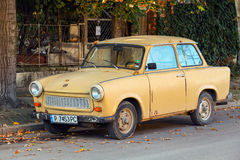 Old yellow Trabant 601s car stands parked on a street side Stock Photos
