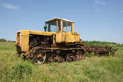 Old yellow tractor Royalty Free Stock Image