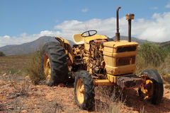 An old yellow tractor Stock Image
