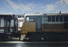 Old yellow train at railway station Royalty Free Stock Photos