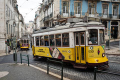 Old yellow tram in the historic center of Lisbon, Portugal Stock Photography