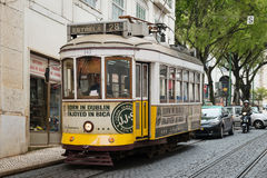 Old yellow tram in the historic center of Lisbon, Portugal Royalty Free Stock Images