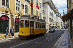 Old yellow tram in Lisbon historic center. Portugal Stock Photos