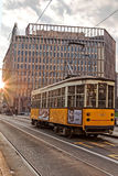 Old yellow tram in the morning light. Street in Milan Stock Photography