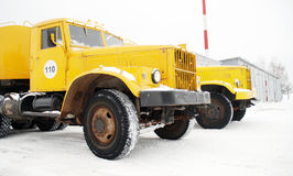 Old yellow truck. Old yellow heavy duty truck on snow stock images