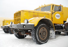 Old yellow truck. Old yellow heavy duty truck on snow stock photo