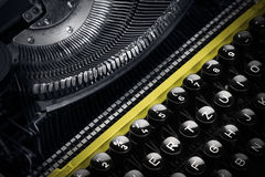 Old yellow typewriter in shadow Royalty Free Stock Photo
