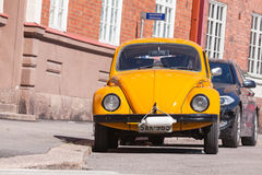 Old yellow Volkswagen beetle, front view Royalty Free Stock Photos