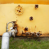Old yellow wall of the fuel tank Royalty Free Stock Images