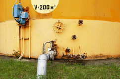 Old yellow wall of the fuel tank Royalty Free Stock Image