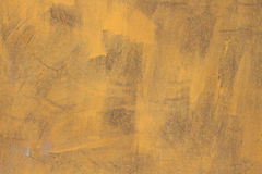 Old yellow wall with paint grunge background Stock Image