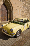 The old yellow wedding car. The antique old yellow wedding car Stock Photography