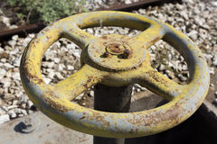Old yellow wheel valve Stock Photography