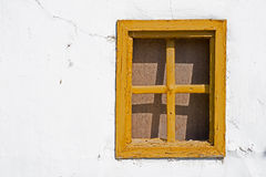 Old Yellow Window on Cracked Wall. Old Yellow Window on Rusty Cracked Wall Royalty Free Stock Photography