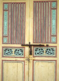 Old yellow wood chinese style. With red strip door in georgetown of Penang Royalty Free Stock Image