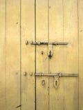 Old yellow wood door. Vertical shot Stock Photos