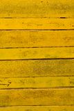 Old yellow wood wall texture Stock Photos