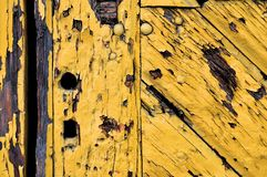 Old yellow wooden door Royalty Free Stock Photos