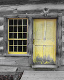 Old yellow wooden door and window. Royalty Free Stock Photo