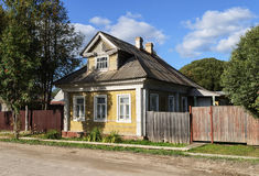 Old yellow wooden house in the country Stock Image