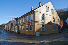 An old yellow wooden house in Halden. Stock Photo