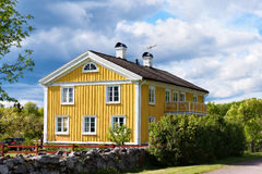 Old yellow wooden house in Sweden Stock Photo