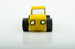 Old yellow wooden toy car Stock Photography