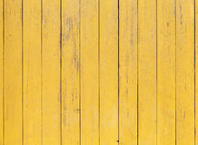 Old yellow wooden wall with cracked paint layer Royalty Free Stock Photography