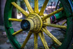 Old yellow wooden wheel of wagon Stock Photos