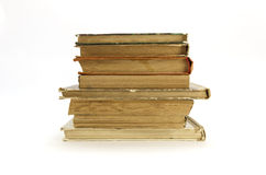 Old, yellowed books on a white background Royalty Free Stock Photography