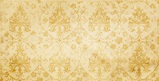 Old yellowed paper background with floral pattern. Stock Photography