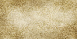 Old yellowed paper background with vintage patterns. Royalty Free Stock Photo