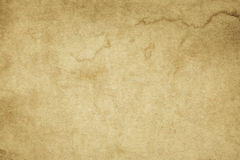 Old yellowed paper texture. Aged and yellowed paper background or texture for the design Royalty Free Stock Photo
