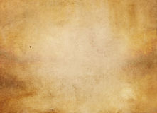 Old yellowed paper texture. Aged and yellowed paper background for the design. Grunge paper texture Royalty Free Stock Photography