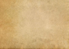 Old yellowed paper texture. Aged dirty and yellowed paper background for the design Royalty Free Stock Photography