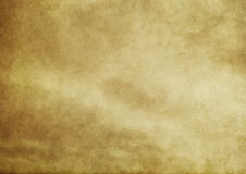Old yellowed paper texture. Aged dirty and yellowed paper background for the design Stock Photo