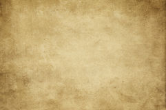 Old yellowed paper texture. Aged yellowed and dirty paper background or texture for design. Grunge style Royalty Free Stock Photo