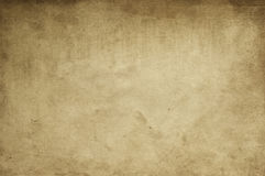 Old yellowed paper texture. Aged yellowed and dirty paper background or texture for design. Grunge style Royalty Free Stock Image