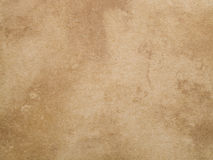 Old yellowed paper texture. Aged yellowed and rough paper background or texture for design Stock Photo