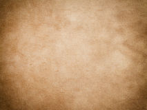 Old yellowed paper texture. Aged yellowed and rough paper background or texture for design Stock Photography