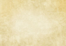 Old yellowed paper texture. Aged stained and yellowed paper background for the design Stock Images