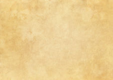 Old yellowed paper texture. Aged stained and yellowed paper background for the design Royalty Free Stock Photo