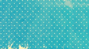 Old yellowed polka dots paper background Royalty Free Stock Photo