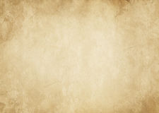 Old yellowed and spotted paper texture. Royalty Free Stock Image