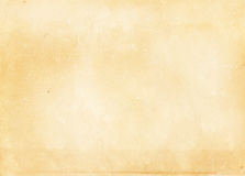 Old yellowed and stained paper texture. Yellowed aged paper background for the design Royalty Free Stock Photography