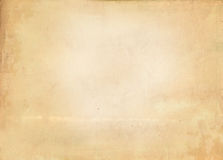 Old yellowed and stained paper texture. Yellowed aged paper background for the design Royalty Free Stock Images