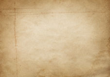Old yellowed and stained paper texture. Stock Image