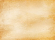 Old yellowed and stained paper texture. Royalty Free Stock Image