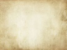 Old yellowed stained paper texture. Aged dirty and yellowed paper background for the design. Grunge paper texture Stock Images